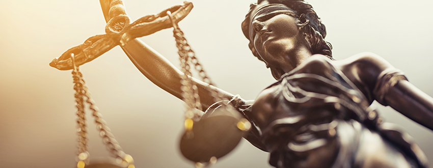 Blindfolded statues weighs whether or not to use an MFT solution in the scales of justice