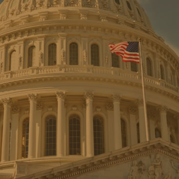 US capitol building with US flag flying in foreground to emphasize FISMA Compliant File Transfers